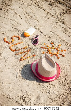 Word And Shape Of Sun, Sunglasses, Sun Lotion And Straw Hat At Beach