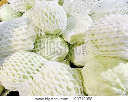 Vegetable Stack of Delicious Fresh Green Cabbage in Supermarket or Grocery Shop.