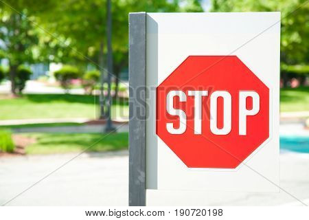Stop sign and sunlight at park in boston .