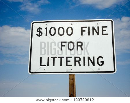 Penalty for littering sign with the sky