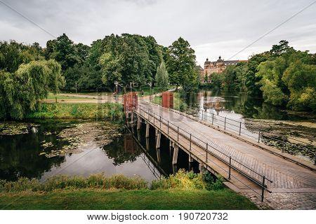 Copenhagen Denmark - August 10 2016. Bridge over pond in Churchill Park in Copenhagen Denmark a cloudy day of summer