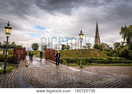 Copenhagen Denmark - August 10 2016. People is walking in Churchill Park in Copenhagen Denmark a rainy day of summer