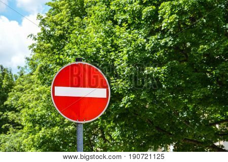 One way street sign shows wrong direction