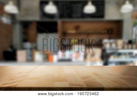 image of wooden table in front of bar abstract blurred background of restaurant lights