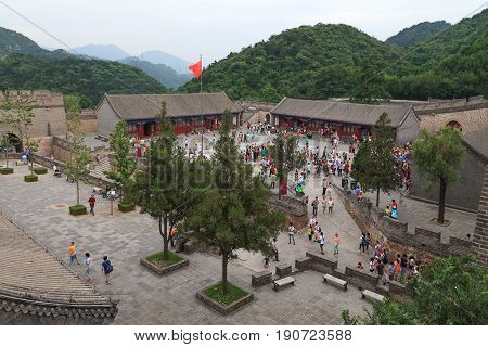 Badaling China - July 26, 2013: tourists getting together to visit Great Wall of China on Badaling territory, view from above