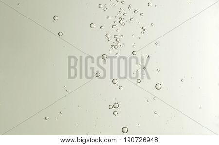 Some nice cold champagne bubbles soars over a blurred background