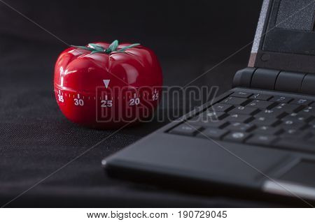 Mechanical Tomato shaped kitchen timer for cooking studying and working.
