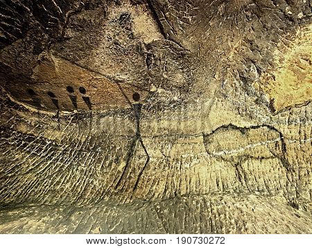 Paint Of Human Hunting On Sandstone Wall, Prehistoric Picture. Black Abstract Art In Sandstone Cave.