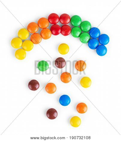 Colorful delicious chocolate candies are lying in several rows forming a square. Sweets are sorted by color. Festival and happiness concept. Isolated on a white background