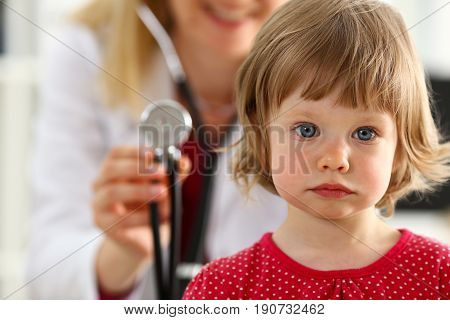 Little Child With Stethoscope At Doctor Reception
