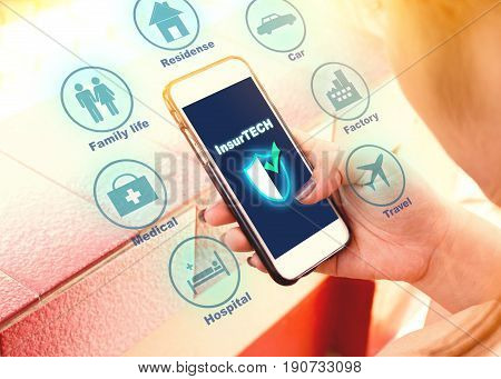 Insurance technology (Insurtech) concept woman looking data information on smartphone.