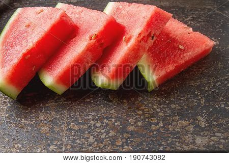 Watermelon Cut Into Slices. Grey Stone Background. Autumn Photos