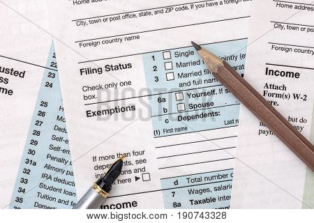 2017 Year Tax Form 1040 With Pencil And Pen.
