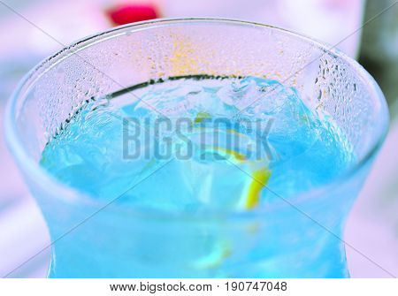 Blue cocktail with blue curacao liqueur. top view. Blue cocktail in glass.