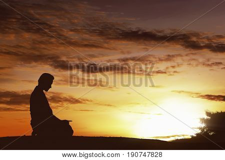 Silhouette Of Asian Muslim Man Praying On A Hilltop