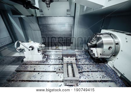 Working area of modern double-spindle CNC metalworking machine. Abstract industrial background.