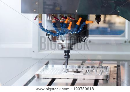 Working area of modern CNC milling machine. Abstract industrial background.