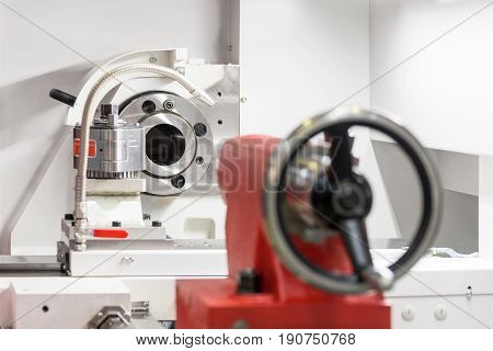 Working area of modern lathe metalworking CNC machine. Abstract industrial background.