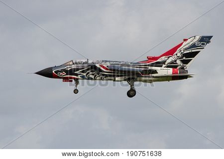 RAF BRIZE NORTON UNITED KINGDOM - JUNE 9: An Italian Tornado in new colour scheme arrives to refuel on route tot he RAF Cosford Air Show on June 9th 2017 in Brize Norton Oxfordshire UK
