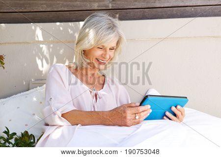 Smiling Older Lady With Digital Tablet Outside