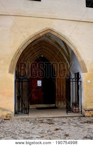 Gate. Old medieval saxon lutheran church in Sighisoara, Transylvania, Romania