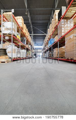 Large hangar warehouse industrial and logistics companies. Warehousing on the floor and called the high shelves.