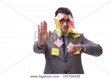 Businessman with many reminders isolated on white