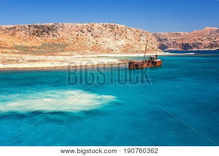 rusting shipwreck at the seaside near by Crete island