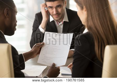 Employers or recruiters holding reviewing bad poor cv of unemployed worried nervous applicant waiting for result, employment and recruitment concept, rejected job application, failed interview, close up