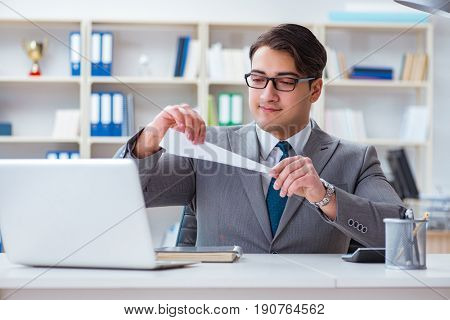 Businessman with paper airplane in office