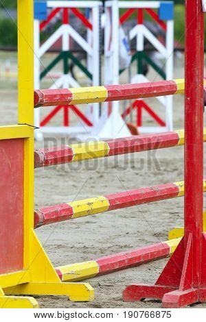 Colorful vertical shot of show jumping hurdles