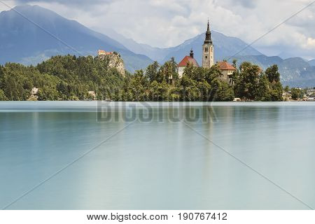 Beautiful View Of Lake Bled With Island, Church And Castle With Mountain Range (stol, Vrtaca, Begunj