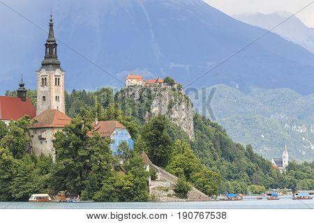 Bled, Slovenia - June 3, 2017: Tourists Visiting The Cerkev Marijinega Vnebovzetja Church In The Isl