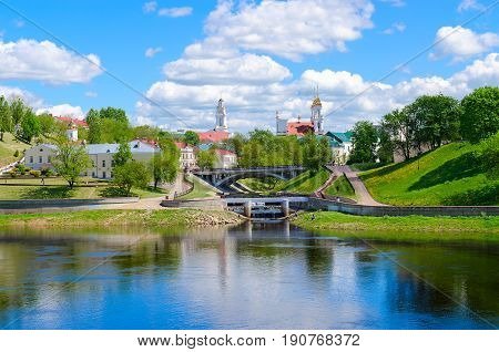 Beautiful view of historical center of Vitebsk near rivers Western Dvina and Vitba Belarus. Holy Spirit Monastery Resurrection Church and Town Hall