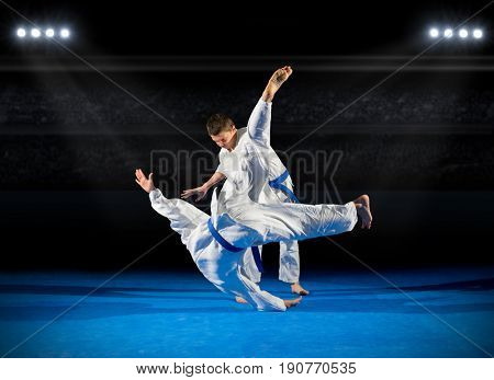Two boys martial arts fighters at sports hall