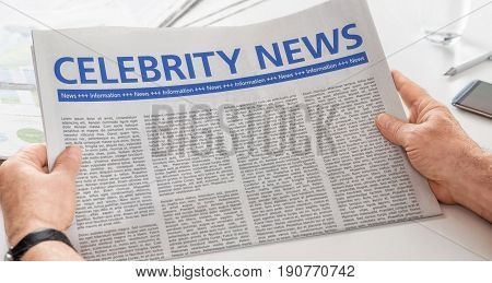 Man reading newspaper with the headline Celebrity News