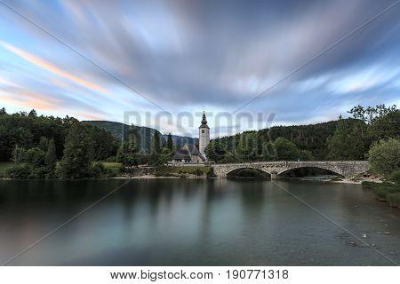 Bohinj Slovenia - June 5 2017: Church of St John the Baptist in Lake Bohinj a famous destination not far from lake Bled in Slovenia at sunset.