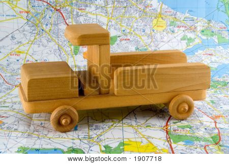 Wooden Toy Truck On Road Map
