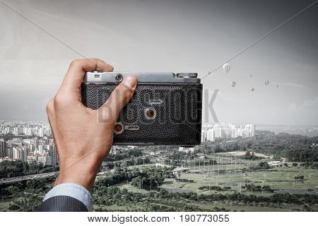 Old analog camera on male hands