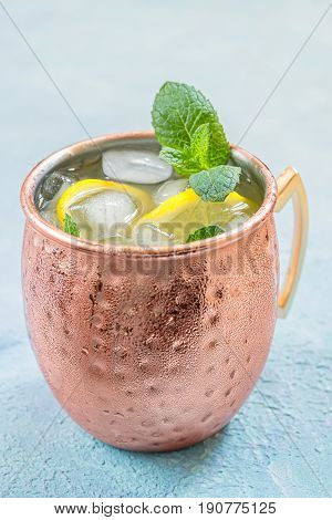 Cold Moscow Mules cocktail with ginger beer, vodka and lemon