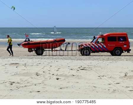 Castricum, The Netherlands - June 10, 2017: Speedboat, Surf Life Saving Vehicle And Crew On The Beac