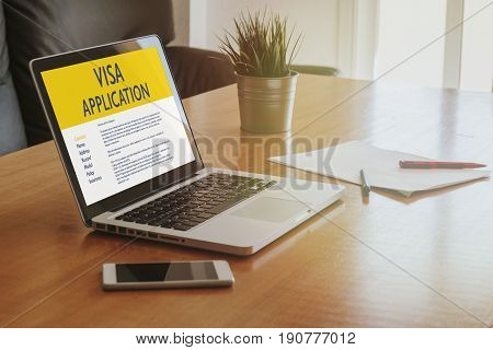 Visa Application form in a laptop computer in the office.