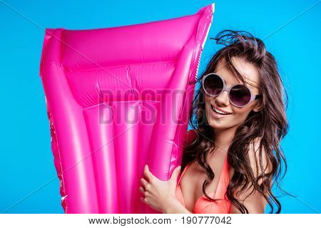 Attractive Young Woman In Sunglasses And Bikini Holding Air Mattress And Smiling At Camera