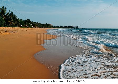 Beautiful Induruwa Beach Sri Lanka with blue water