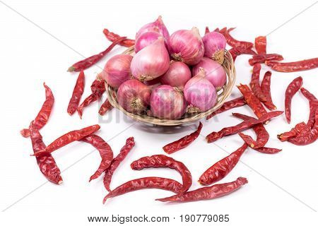 Dried chilies and  shallots  on white background.