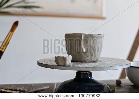 Close up of still life fresh clay pot for flowers or accessories carefully and lovingly carved out of fresh mud material artisan hand made piece