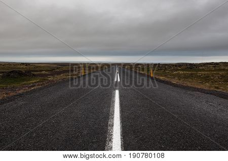 Iceland Road Leading Straight To The Horizon. Empty Straight Road Line In Rural Icelandic Landscape