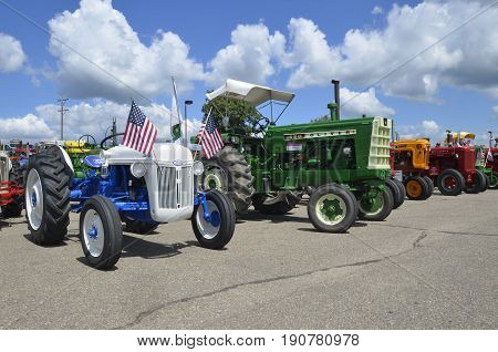 YANKTON, SOUTH DAKOTA, August 19, 2106: A Restored blue Ford and Oliver tractor are displayed at the annual Riverboat Days celebrated the third weekend of August in Yankton, South Dakota.