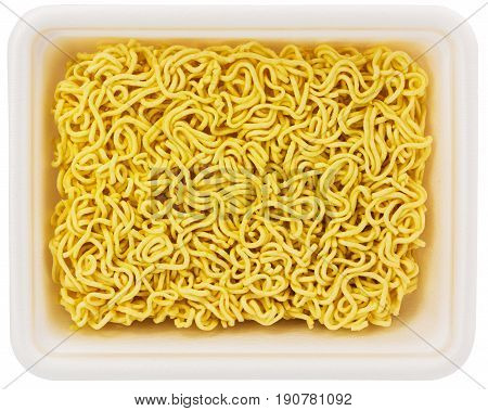 uncooked instant noodle in rectangular styrofoam cup isolated on white background - top flat lay view