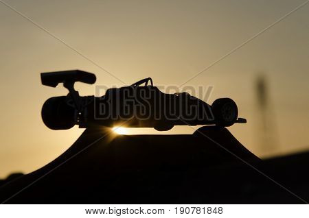 Outline of vintage single-seater with sunset in background